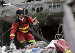 A rescue team member from Spain searches for victims at a collapsed building at the village of Manta, after an earthquake struck off Ecuador's Pacific coast, April 21, 2016. REUTERS/Henry Romero