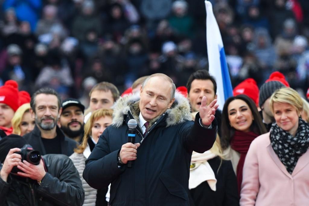 Kovo 3 d. Maskvos Lužnikų stadione buvo surengtas mitingas kandidatui į prezidentus V.Putinui paremti. Scanpix nuotr.